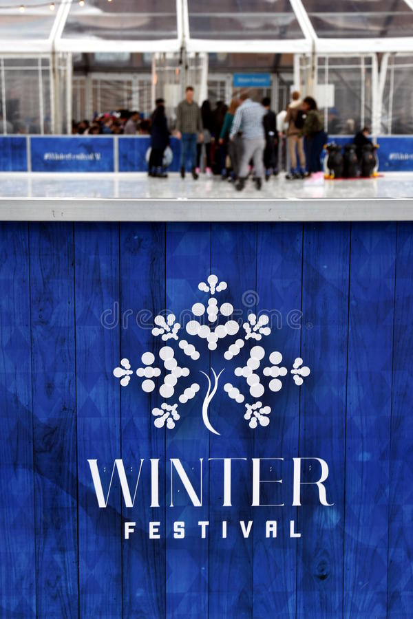 Winter Festival logo on the ice rink's fence. Sydney, Australia - Jul 17, 2016. 'Winter Festival' logo on the ice rink's fence. The Winter Festival in Sydney is royalty free stock images