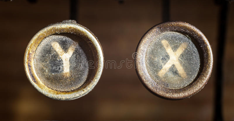 X and Y. Part of an old typewriter, view on y and x buttons, dusty surfaces. It can symbolizes chromosomes as well stock photography
