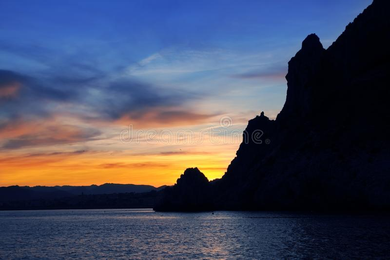 xabia захода солнца моря san javea плащи-накидк antonio стоковые изображения