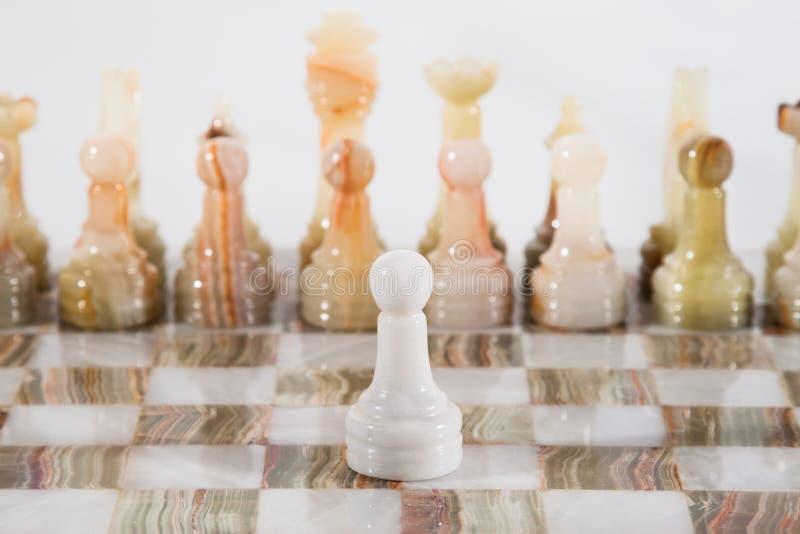 Xadrez de mármore no branco fotografia de stock royalty free