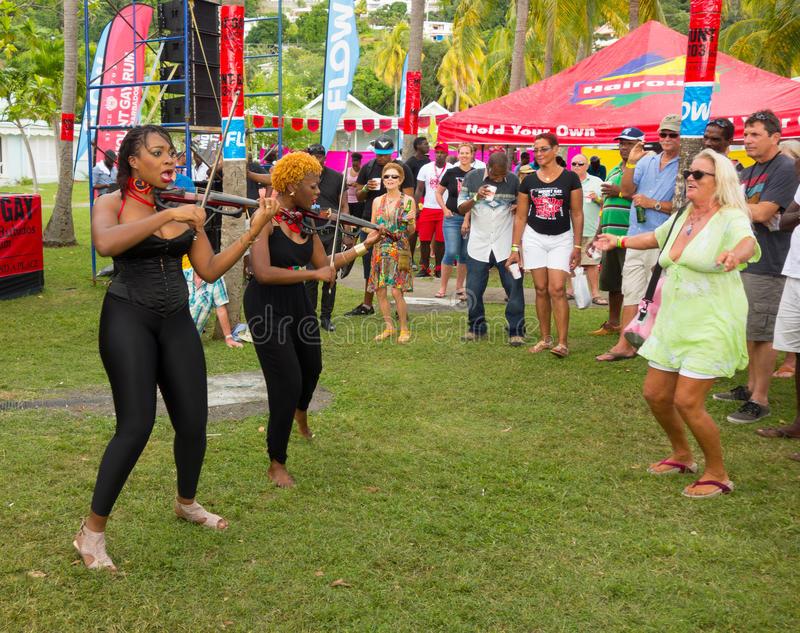 The xavier strings performing at the bequia music fest. Female musicians from trinidad playing with energy at an annual event in the caribbean stock image