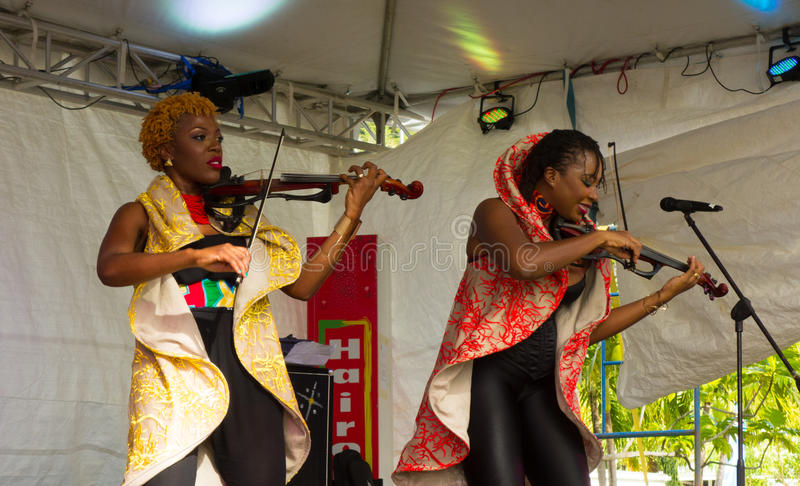 The xavier strings performing at the bequia music fest. Female musicians from trinidad playing with energy at an annual event in the caribbean royalty free stock photography