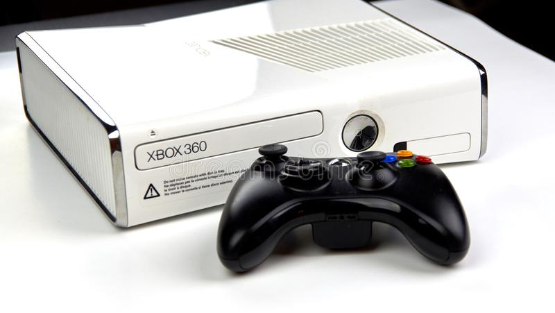 Xbox 360 video gaming console. MONTREAL, CANADA - SEPTEMBER 8, 2018: Xbox 360 video gaming console with a controller on a table. The Xbox 360 is a home video royalty free stock photos