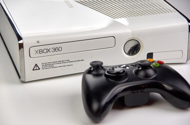 Xbox 360 video gaming console. MONTREAL, CANADA - SEPTEMBER 8, 2018: Xbox 360 video gaming console with a controller on a table. The Xbox 360 is a home video stock images