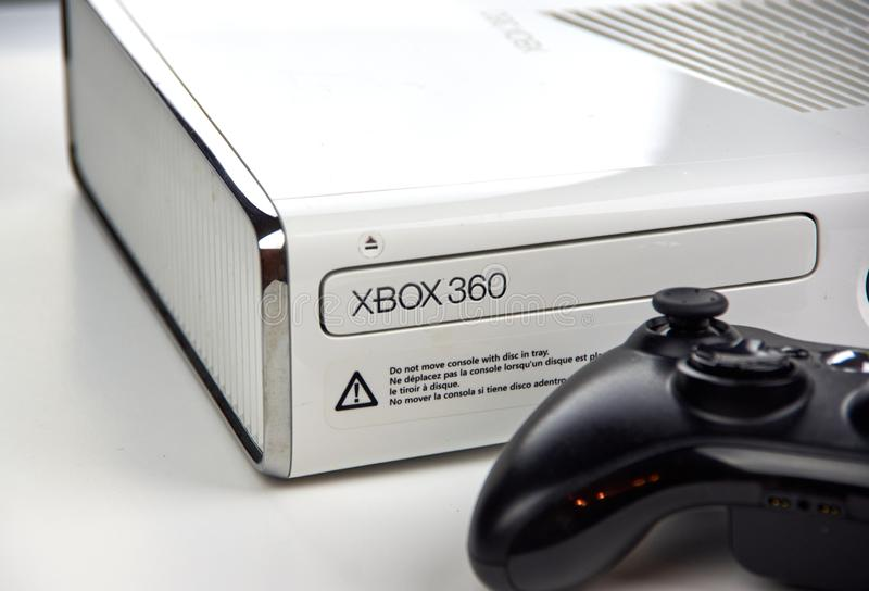 Xbox 360 video gaming console. MONTREAL, CANADA - SEPTEMBER 8, 2018: Xbox 360 video gaming console with a controller on a table. The Xbox 360 is a home video royalty free stock image