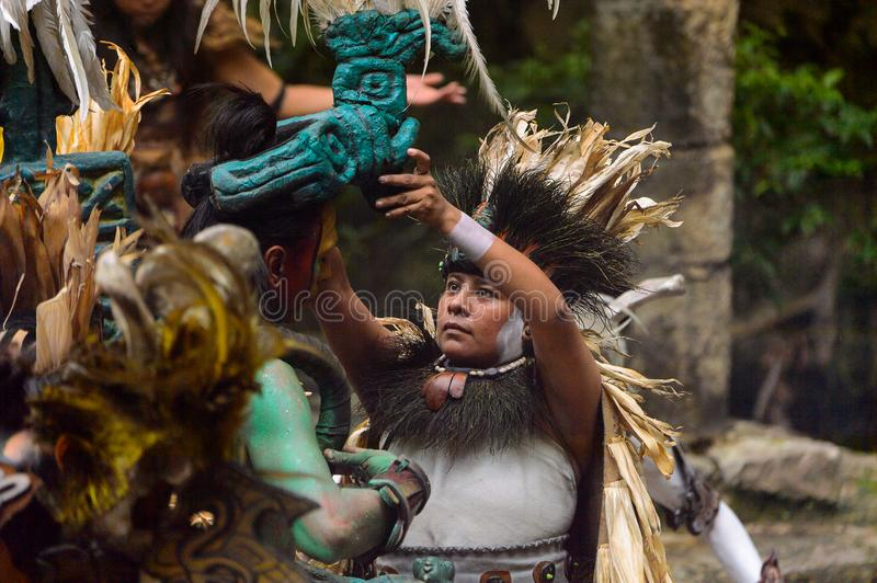 Mayan people in Mexico. XCARET, MEXICO - NOV 8, 2015: Unidentified man wears a costume of a Maya indian. The Mayan are a group of Indigenous people of stock images