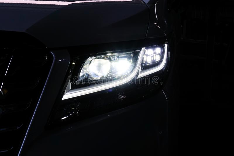 Macro view of modern black car xenon lamp headlight 12 royalty free stock photo