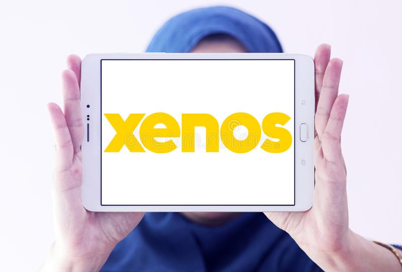 Xenos retailer logo. Logo of Xenos retailer on samsung tablet holded by arab muslim woman royalty free stock images