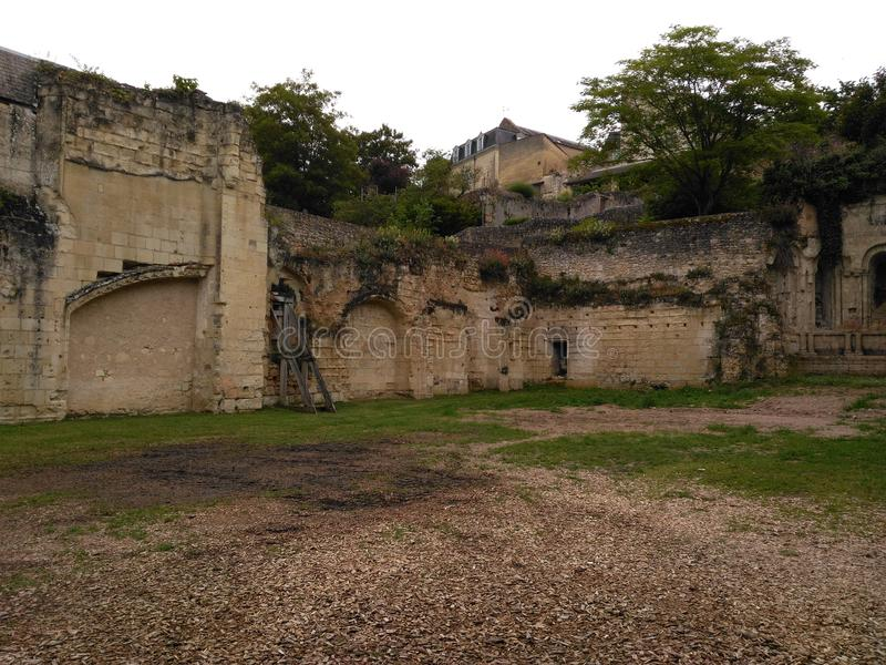 XI century memory. Door path Stone hole greenery green Window tree Pebbles Wall stock photos