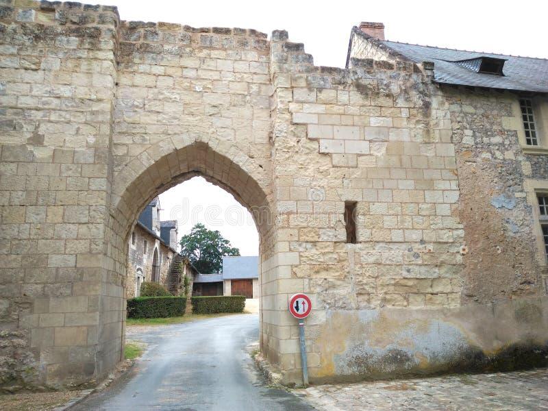 XI century ruin. Door bridge Road path Stone hole greenery green Window House stock photos