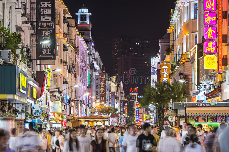 Xiamen, China Nightlife. XIAMEN, CHINA - JUNE 11, 2014: Pedestrians stroll down Zhongshan Road at night. The road is the main commercial street in Xiamen and royalty free stock image