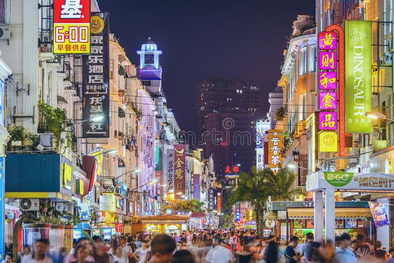 Xiamen, China Nightlife. XIAMEN, CHINA - JUNE 11, 2014: Pedestrians walk on Zhongshan Road at night. The road is the main commercial street in Xiamen and parts stock image