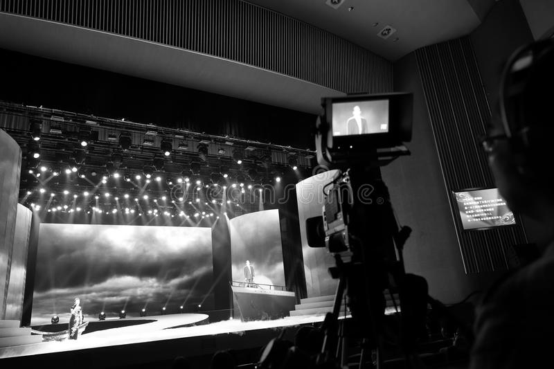 Xiamen tv station filming with a video camera. October 31, 2015 afternoon, tan kah kee song poetry reading activities were held in xiamen people's hall, amoy royalty free stock photo