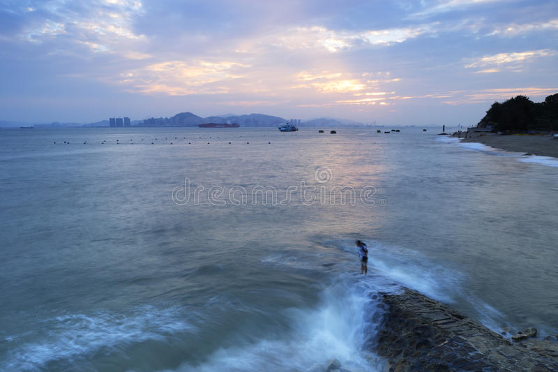 Xiamen university baicheng (white city )sunset. Tourist bravely stand in the forefront, baicheng seaside of xiamen university, china stock photos