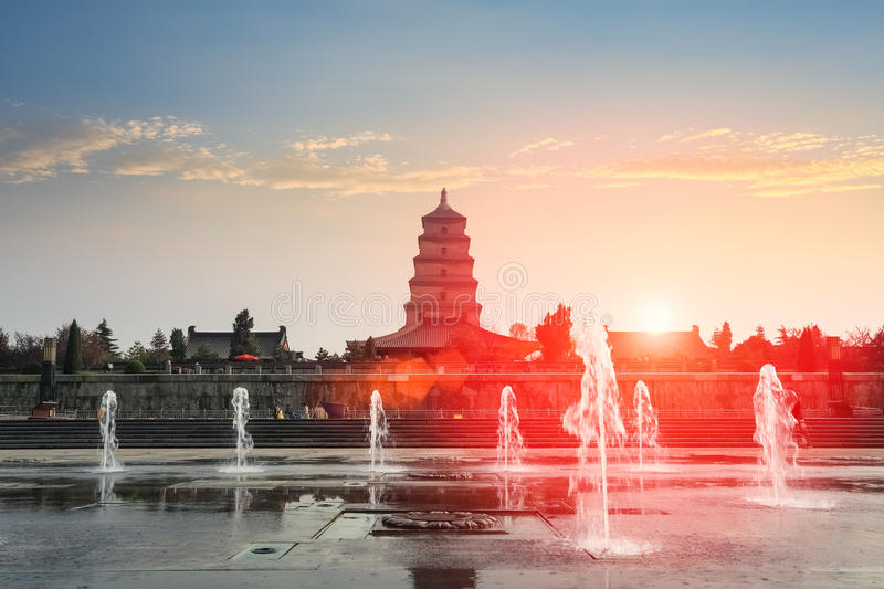 Xian big wild goose pagoda at dusk. Xian big wild goose pagoda and fountain at dusk royalty free stock photo