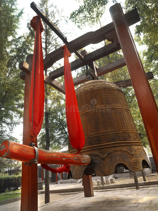 Xian - China. A large Buddhist bell outside the Small Wild Goose Pagoda in the city of Xian in the Shaanxi province of central China stock photo
