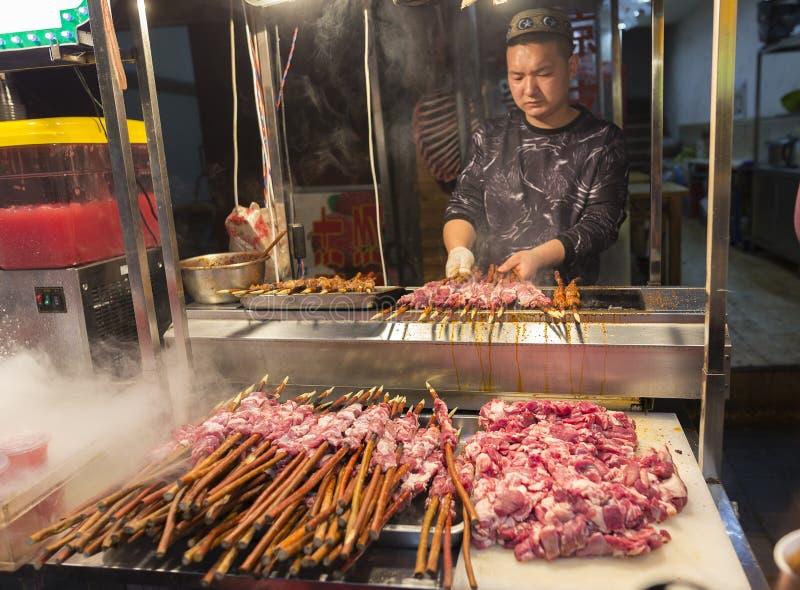 XIAN, CHINA - APRIL 4 2018: Hui muslim prepares street food in f royalty free stock photography