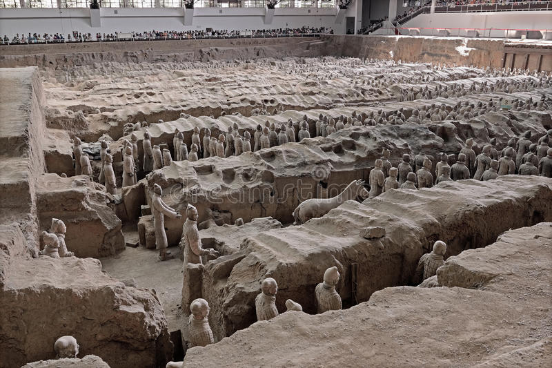 Xian China-Terracotta Army Soldiers Horses No.1 pit. Tourists travel to the Orient in Xian in China,visit the ever popular Terracotta Army Soldiers Horses royalty free stock photo