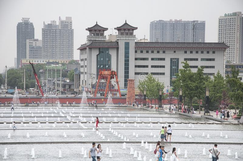Xian North Square Tang Cultural Area. The city of Xian China and the North Square Tang Cultural area water fountain in Shaanxi province on an overcast day royalty free stock photo