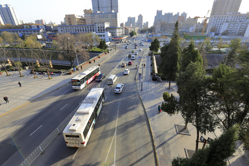Xian traffic in winter. Long bus on the road of xian city, shaanxi province, china royalty free stock image