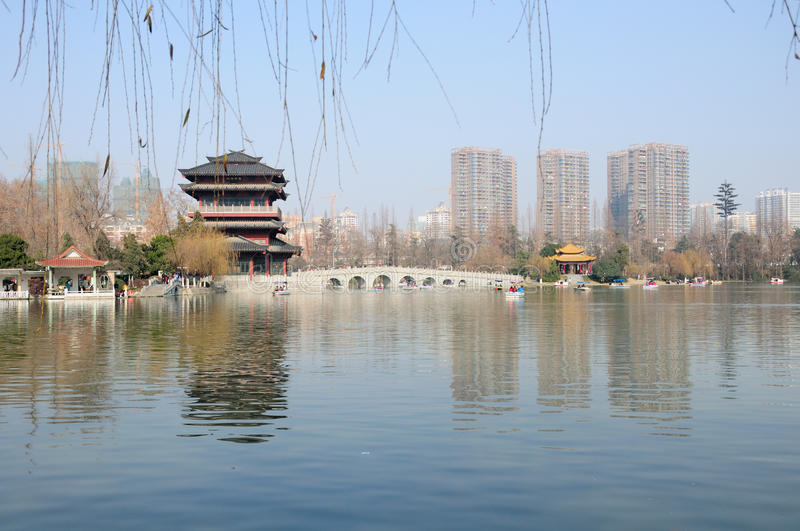 Xiaoyaojin Park Hefei China. Tourists boating around the lake at Xiaoyaojin park in Hefei China. Xiao Yao pavilion and Du Jin bridge on the edge of the lake with royalty free stock photography