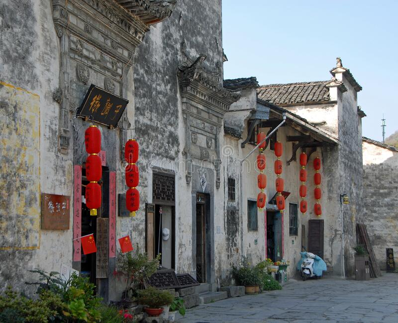 Xidi Ancient Town in Anhui Province, China. The historical town of Xidi showing old houses with red lanterns. A traditional street in the ancient town of Xidi royalty free stock photography