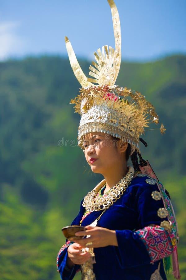 Miao Woman Festival Traditional Horn Headdress. Xijiang, China - September 15, 2007: Ethnic Miao woman wearing traditional festival costume and silver horn stock photography