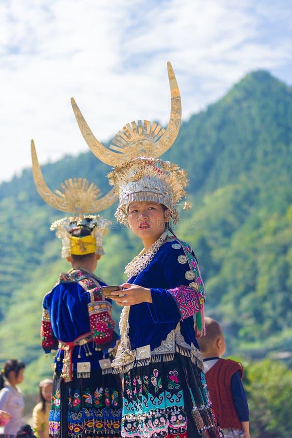 Miao Ethnic Minority Traditional Festival Mountain. Xijiang, China - September 15, 2007: An ethnic minority Miao woman in traditional festival clothes and silver royalty free stock photo