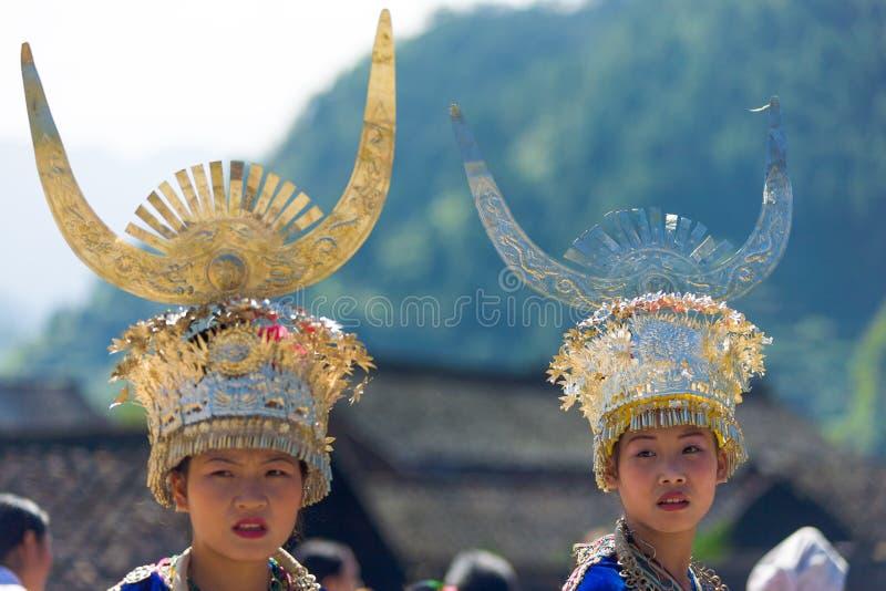 Xijiang Miao Minority Women Festival Clothes China. Xijiang, China - September 15, 2007: Miao women wearing traditional silver horn headdress and festival stock images