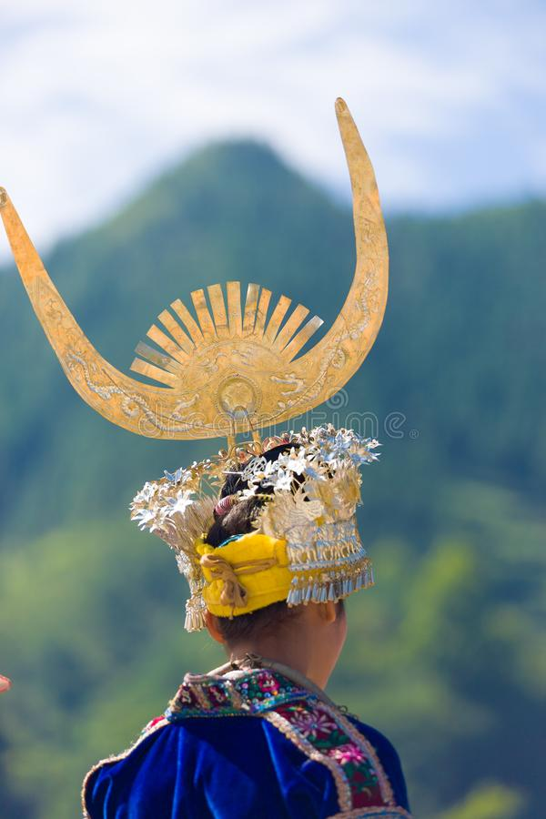 Miao Woman Rear Headdress Festival Costume. Xijiang, China - September 15, 2007: Rear detailed view of ethnic minority Miao woman in traditional silver horn stock image