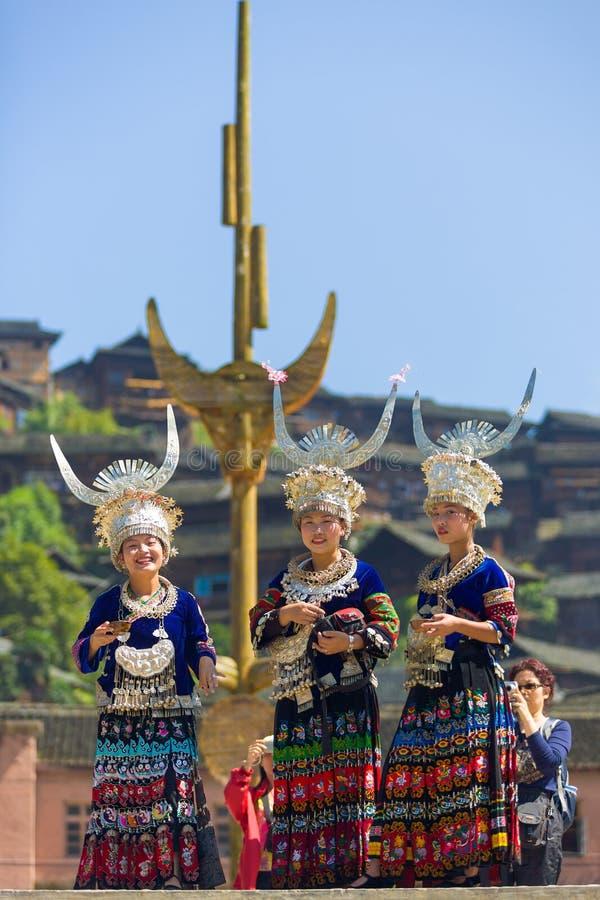 Miao Women Traditional Festival Regalia Headdress. Xijiang, China - September 15, 2007: Three Miao women wearing full traditional festival regalia with silver royalty free stock photography