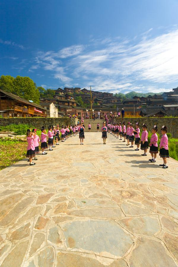 Xijiang Miao Village Festival Girls Ceremony China. Xijiang, China - September 15, 2007: Cute adolescent girls prepare for festival ceremony in traditional pink stock photo