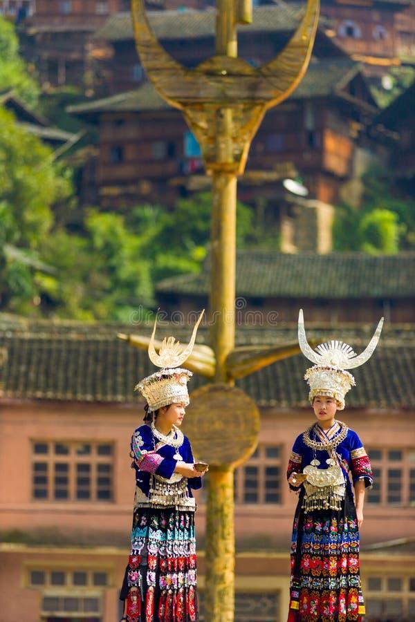 Xijiang Miao Women Traditional Festival Clothes. Xijiang, China - September 15, 2007: Two ethnic minority Miao women wearing traditional clothes and silver stock image