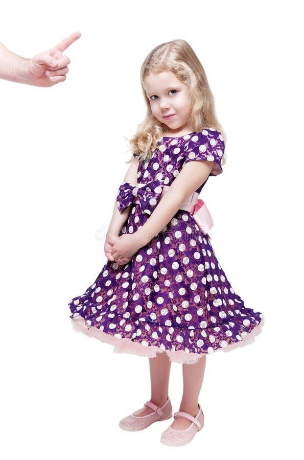 Xingamento bonito da menina por seu pai isolado imagem de stock royalty free