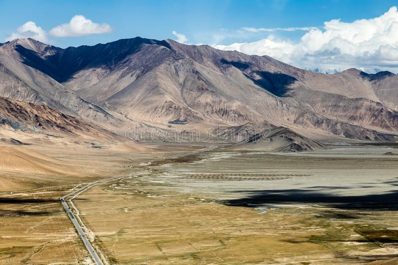 Xinjiang, China: bird's view of Karakorum highway running on the Pamir Plateau. Connecting Kashgar to the Pakistan Border, this road has some of the royalty free stock photo