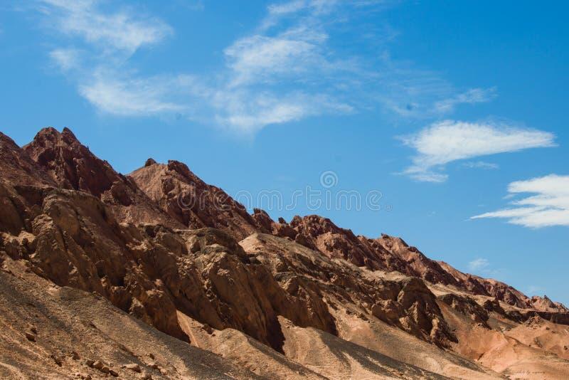 Xinjiang, montanha flamejante, montanha vermelha fotografia de stock