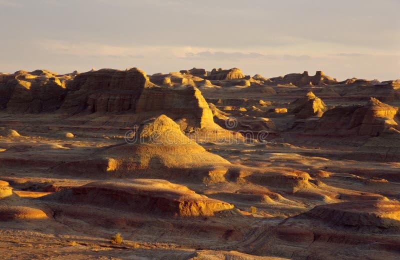 Xinjiang spökestad på solnedgången arkivfoton