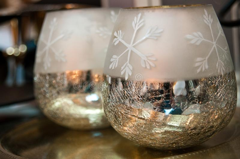 Two shiny Christmas bowls as home decorations. Xmas abstract: two new and shiny Christmas bowls to house candles or other decorations. Holiday abstract and home royalty free stock photos