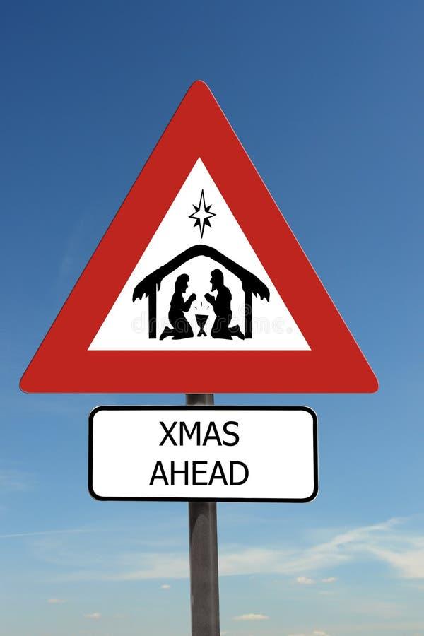 Xmas Ahead sign. Xmas Ahead warning roadsign over blue sky royalty free stock photography