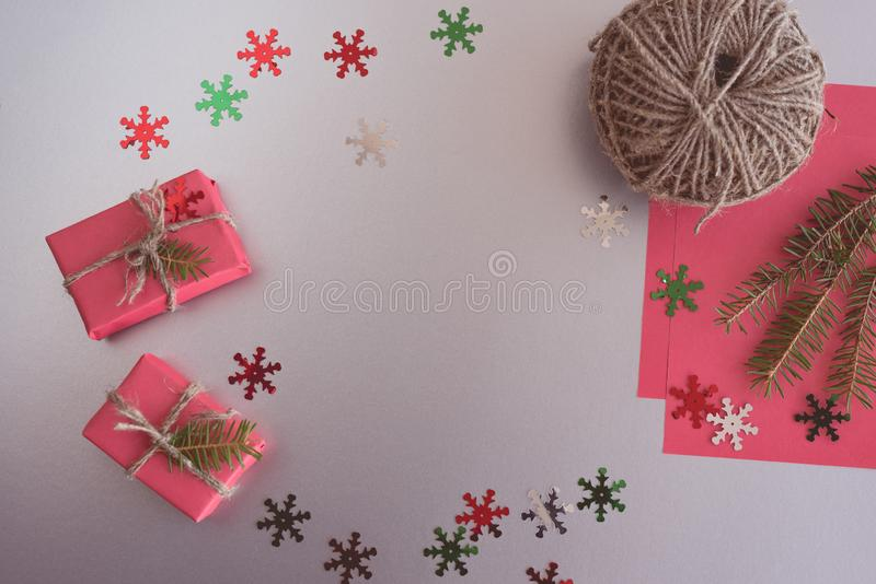Xmas background with gift boxes, clews, paper decorations on red. Preparation for holidays. Gift wrapping. Copy space. Christmas background with gift boxes stock photography