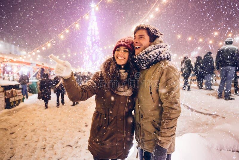 Girlfriend Showing Something Boyfriend Having Fun On Outdoor Christmas Market stock images