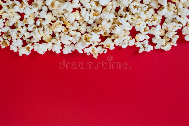 Xmas Christmas holiday concept. Top above high angle overhead closeup view photo of tasty delicious yummy popcorn with copy space. Place for design isolated stock images
