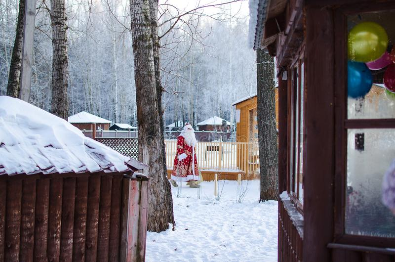 Xmas, cold, December. Santa Claus going with a bag of gifts in the winter on snow-covered field. N stock images