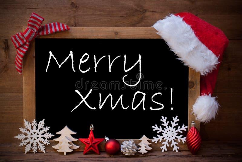 Xmas de Santa Hat Christmas Decoration Merry do quadro-negro de Brown fotografia de stock