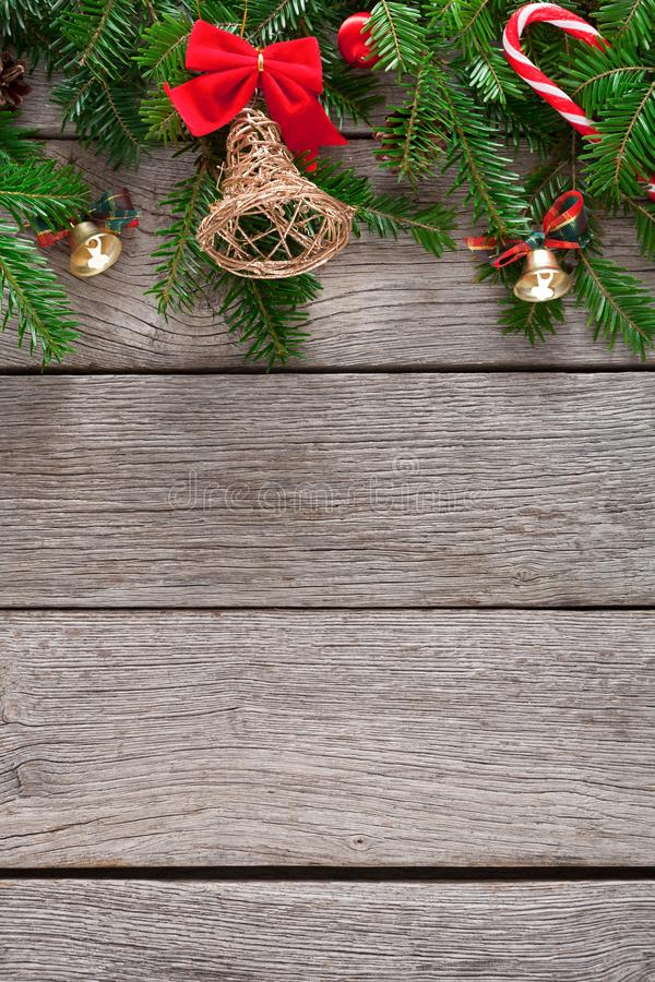 Christmas decoration, ornaments and garland frame background. Xmas decoration border background. Fir tree branches border with bells, candy canes and pine cones royalty free stock photo