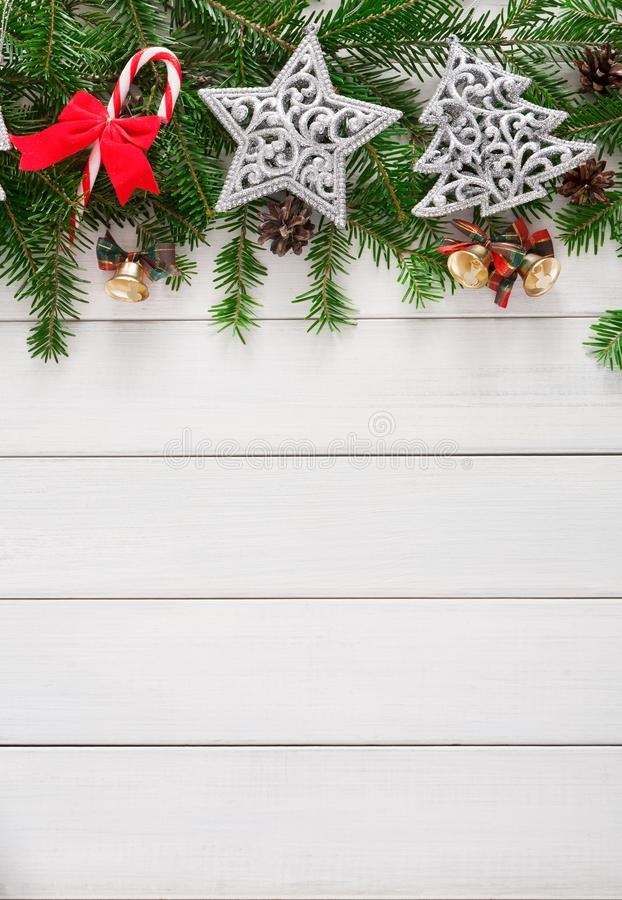 Christmas decoration, ornaments and garland frame background. Xmas decoration border background. Fir tree branches border with stars, candy canes and pine cones stock photography