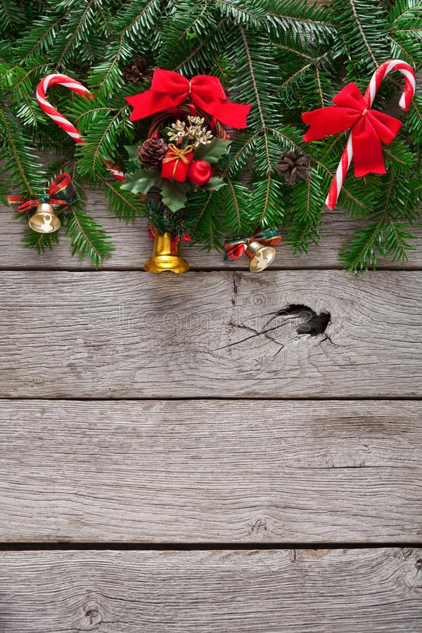 Christmas decoration, ornaments and garland frame background. Xmas decoration, garland frame concept background, top view with copy space on gray rustic wooden royalty free stock image