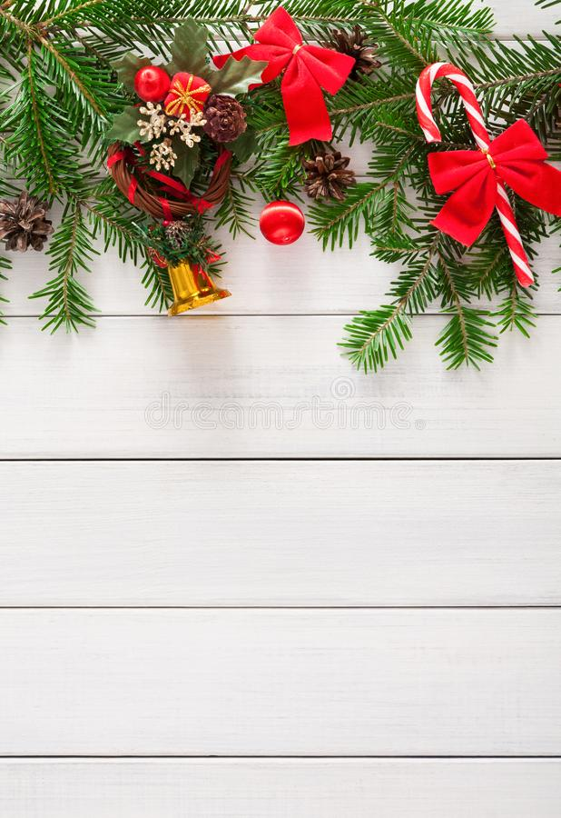 Christmas decoration, ornaments and garland frame background. Xmas decoration, garland frame concept background, top view with copy space on white wooden surface royalty free stock image