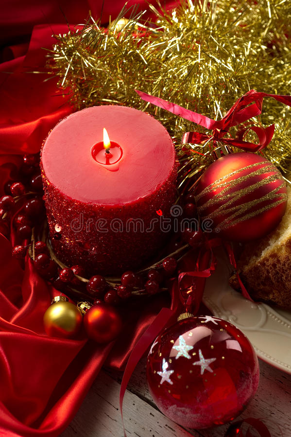 Xmas decorations. With candle and gold ribbon stock photo