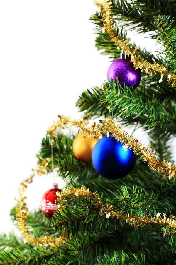 Xmas decorations on christmas tree stock image